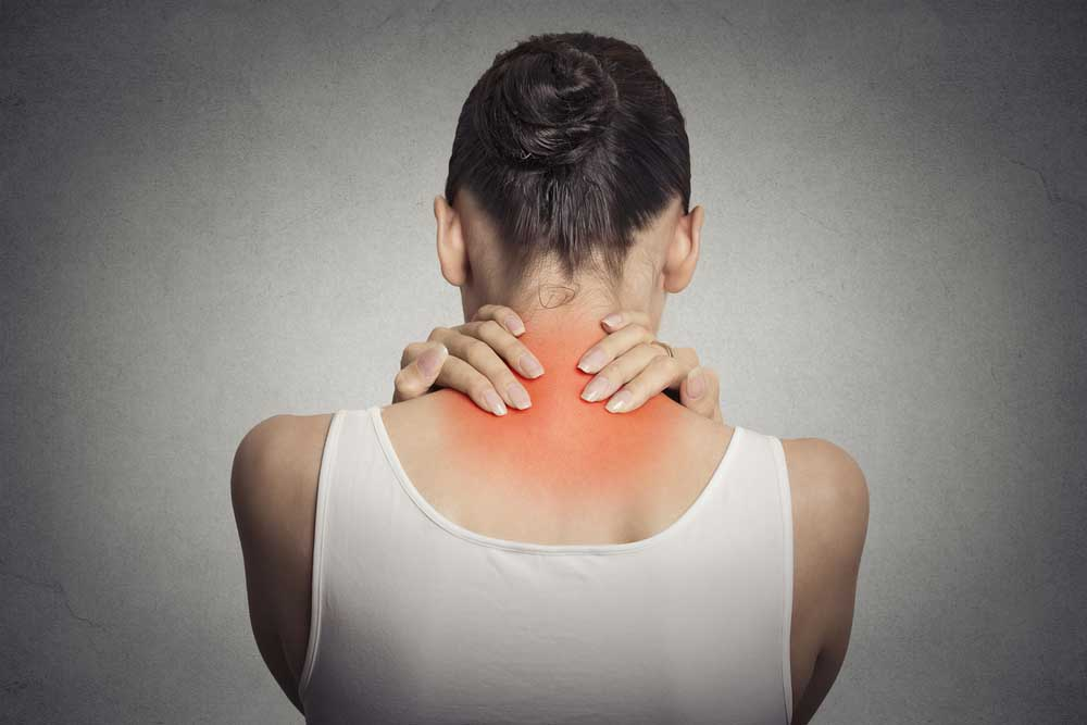woman has neck pain in San Diego, CA